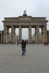 Photo of young couple at Brandenburg Gate Berlin